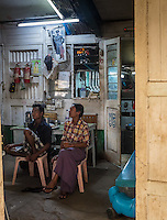 YANGON, MYANMAR - CIRCA DECEMBER 2013: Workers taking a rest in the Yangon Central Railway Station