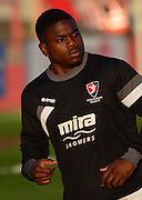 Shaquille McDonald warms up during the Sky Bet League 2 match between Cheltenham Town and Cambridge United at Whaddon Road, Cheltenham, England on 14 April 2015. Photo by Alan Franklin.