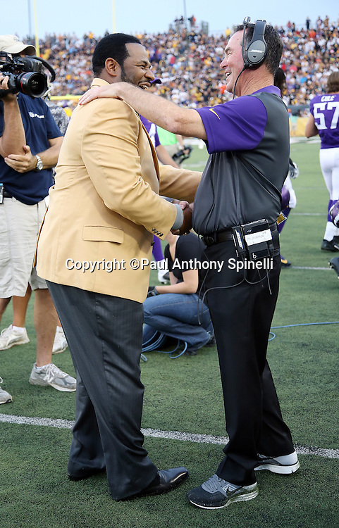 (L-R) Former Pittsburgh Steelers running back Jerome Bettis shakes hands with Minnesota Vikings head coach Mike Zimmer as he is introduced as a newly enshrined member of the NFL Pro Football Hall of Fame before the 2015 NFL Pro Football Hall of Fame preseason football game against the Minnesota Vikings on Sunday, Aug. 9, 2015 in Canton, Ohio. The Vikings won the game 14-3. (©Paul Anthony Spinelli)