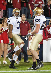 November 28, 2009; Stanford, CA, USA;  Notre Dame Fighting Irish wide receiver Michael Floyd (3) celebrates with tight end Mike Ragone (83) after scoring a touchdown against the Stanford Cardinal during the first quarter at Stanford Stadium.  Stanford defeated Notre Dame 45-38.