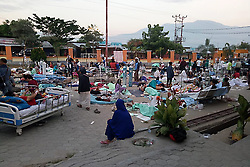 September 29, 2018 - Palu, Sulawesi, Indonesia - Patients staying in a yard of Undata Regional Hospital in Palu, Indonesia's Central Sulawesi province. At least 48 people were killed and 356 others injured as strong earthquakes and ensuing tsunami rattled Indonensia's Central Sulawesi province on Friday, a disaster agency official said on Saturday. (Credit Image: © Indonesian National Board for Disaster Management/Xinhua via ZUMA Wire)