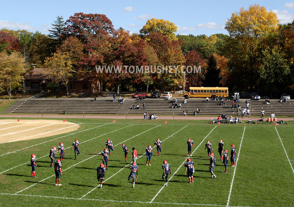 Peekskill, NY - Peekskill High School football players form a circle and stretch to warm up for the second half of a game in Peekskill on Oct. 18, 2008.