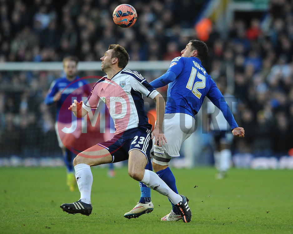 Birmingham City's Lee Novak jostles for the ball with West Bromwich Albion's Gareth McAuley - Photo mandatory by-line: Dougie Allward/JMP - Mobile: 07966 386802 - 24/01/2015 - SPORT - Football - Birmingham - ST Andrew's Stadium - Birmingham City v West Bromwich Albion - FA Cup Forth Round