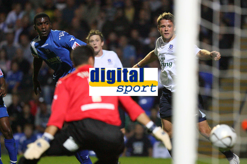 Photo: Pete Lorence.<br />Peterborough United v Everton. Carling Cup. 19/09/2006.<br />Mark Tyler is left standing as James Beattie's header sails into the back of the net for a goal.