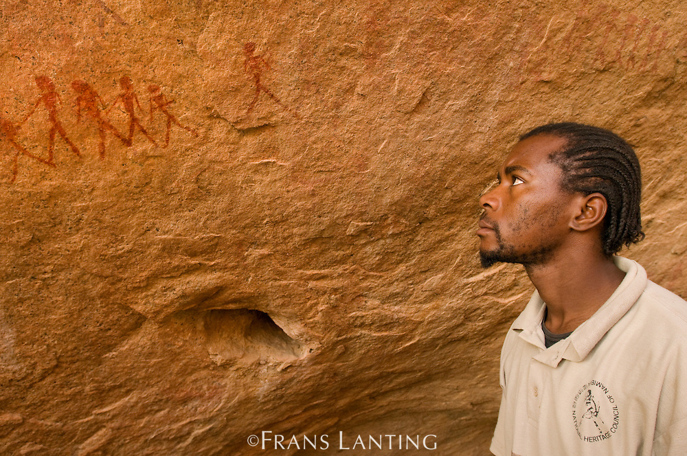 Guide at 'White Lady' rock art panel, Brandberg, Tsiseb Conservancy, Damaraland, Namibia