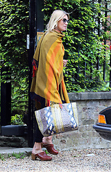Supermodel Kate Moss wrapped in a blanket and wearing a pair of brown clogs as she leaves her house in London, UK. 15/05/2014<br /> BYLINE MUST READ : JAMESY/GOTCHA IMAGES<br /> <br /> Copyright by © Gotcha Images Ltd. All rights reserved.<br /> Usage of this image is conditional upon the acceptance <br /> of Gotcha Images Ltd, terms and conditions available at<br /> www.gotchaimages.com