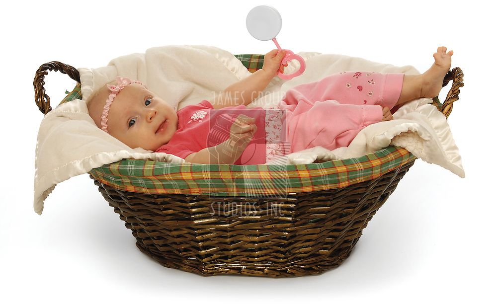Cute baby in a basket on a white background