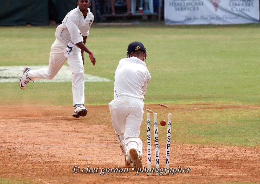 A Somerset bowler reacts after his ball hit the stumps past a St. George's batsman during the first day of Cup Match at the St. George's Cricket Club in St. George's, Bermuda on Thursday, July 28, 2011. The 109th. Annual Cup Match takes place during the two day public holidays of Emancipation Day and Somers Day in Bermuda.