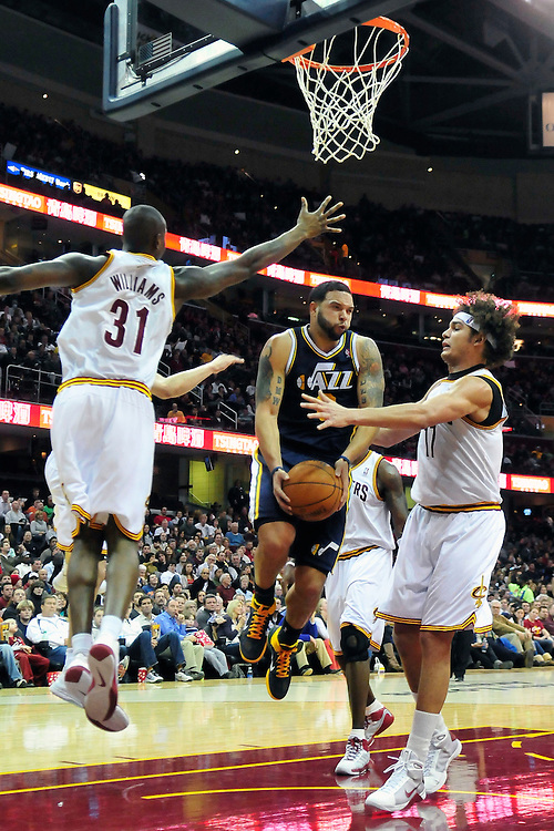 Dec. 20, 2010; Cleveland, OH, USA; Cleveland Cavaliers forward Jawad Williams (31) and Cleveland Cavaliers power forward Anderson Varejao (17) put pressure on Utah Jazz point guard Deron Williams (8) during the third quarter at Quicken Loans Arena. The Jazz beat the Cavaliers 101-90. Mandatory Credit: Jason Miller-US PRESSWIRE