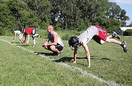 Head coach Matt Weis of Central City watches over a conditioning drill during the first day of football practice at Central City High School in Central City on Wednesday afternoon, August 3, 2011.