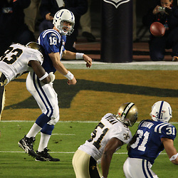 2010 February 07: New Orleans Saints defensive end Bobby McCray (93) hits Indianapolis Colts quarterback Peyton Manning (18) as he throws during a 31-17 win by the New Orleans Saints over the Indianapolis Colts in Super Bowl XLIV at Sun Life Stadium in Miami Gardens, Florida.