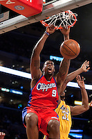 15 January 2010: Center DeAndre Jordan of the Los Angeles Clippers dunks the ball ahile being guarded by Ron Artest of the Los Angeles Lakers during the first half of the Lakers 126-86 victory over the Clippers at the STAPLES Center in Los Angeles, CA.