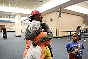 MELISSA LYTTLE   |   Times<br /> Dontrell &quot;Fred&quot; Johnson hugs his mom Hendretta Drummer goodbye at the Palm Beach International Airport. Fred had never left Florida before or been on an airplane, until this day -- when he left for college in Iowa Falls, Iowa. &quot;I'm nervous, but ready,&quot; he told his mom as they parted ways.