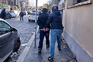 "Roma, 12 Dicembre  2014<br /> Sgomberato dalla polizia un edificio appena occupato dai movimenti di lotta per la casa in via Cesalpino. Lo spazio occupato  è un ""bene"" sequestrato alla 'ndrangheta  della  cosca di San Luca. La polizia arresta un manifestante<br /> Rome, December 12, 2014<br /> Vacated by police a building occupied by the movements of struggle for the house in via Cesalpino. The space occupied had been seized at the 'Ndrangheta clan of San Luca.Police arrest a protester"