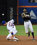 New York Mets Michael Conforto is forced out at second base by Miami Marlins second baseman Dee Gordon, who throws to first base to complete a double play during a baseball game, Sept. 1, 2016, in New York.<br /> (AP Photo/Kathy Kmonicek)