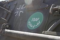 """11 AUG 2003, KABUL/AFGANISTAN:<br /> ISAF Logo mit arabischen Lettern und das Eiserne Kreuz der Bundeswehr auf einem Transportpanzer """"Fuchs""""  des deutschen Kontingents der International Security Assistance Force, ISAF, auf dem militaerischen Teil des Flughafens von Kabul<br /> IMAGE: 20030811-01-006<br /> KEYWORDS: Bundeswehr, Streitkraefte, Streitkräfte,  Logo, Schriftzug, sign, Bundeswehr"""