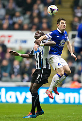 NEWCASTLE-UPON-TYNE, ENGLAND - Tuesday, March 25, 2014: Everton's Leighton Baines in action against Newcastle United's Moussa Sissoko during the Premiership match at St. James' Park. (Pic by David Rawcliffe/Propaganda)