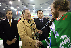 Ernest Aljancic gives Tomaz Vnuk the prize for second place after the sixth game of the Final of EBEL league (Erste Bank Eishockey Liga) between ZM Olimpija vs EC Red Bull Salzburg,  on March 25, 2008 in Arena Tivoli, Ljubljana, Slovenia. Red Bull Salzburg won the game 3:2 and series 4:2 and became the Champions of EBEL league 2007/2008.  (Photo by Vid Ponikvar / Sportal Images)..