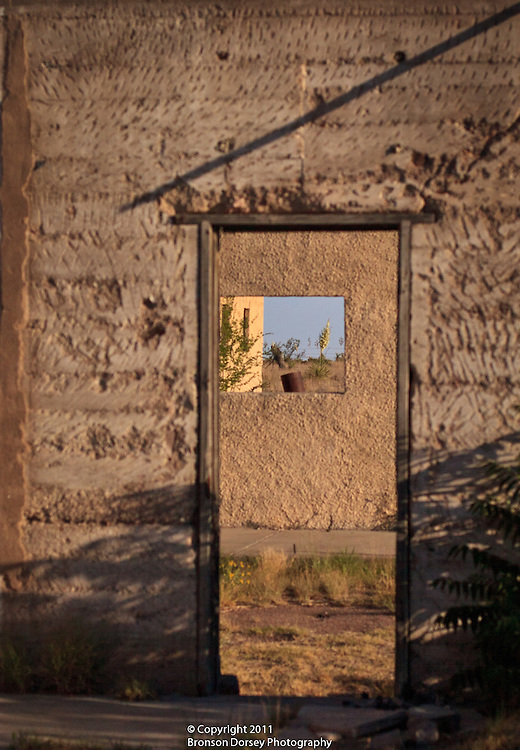 A lone yucca is seen through the crumbling walls of Fort D.A. Russell in Marfa, TX.