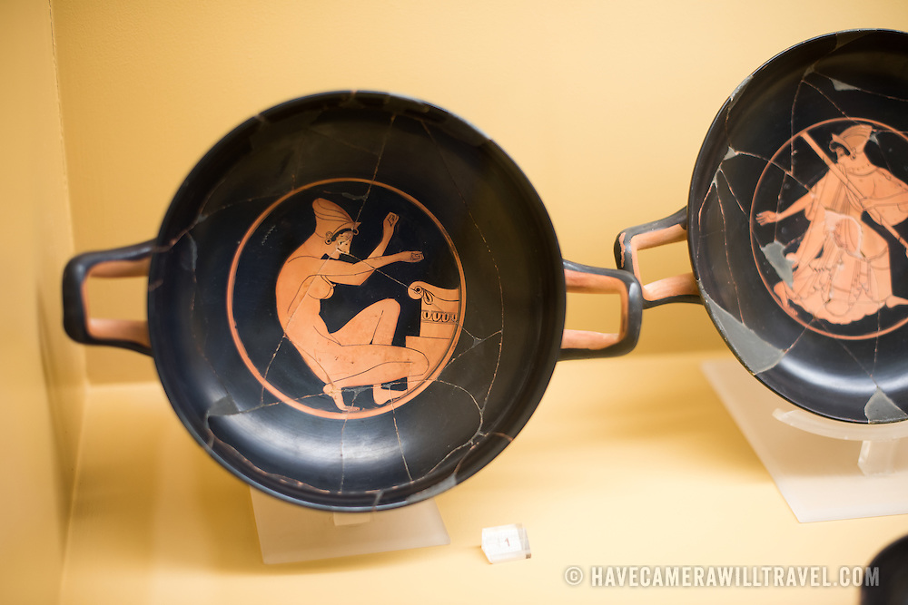 Kylix by the Chairias Painter illustrating a woman kneeling at an altar. Circa 510-500 BC. The Stoa of Attalos is a 1950s recreation of a long pavilion that was originally built around 150 BC. It was part of the Ancient Agora (market). It now houses the Museum of the Ancient Agora, which includes clay, bronze and glass objects, sculptures, coins and inscriptions from the 7th to the 5th century BC, as well as pottery of the Byzantine period and the Turkish conquest.