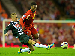 LIVERPOOL, ENGLAND - Tuesday, August 27, 2013: Liverpool's Daniel Sturridge and Notts County's Gary Liddle during the Football League Cup 2nd Round match at Anfield. (Pic by David Rawcliffe/Propaganda)