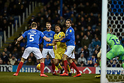 Bristol Rovers Forward, Jonson Clarke-Harris (19) challenged by Portsmouth Defender, Christian Burgess (6) in the box during the EFL Sky Bet League 1 match between Portsmouth and Bristol Rovers at Fratton Park, Portsmouth, England on 19 February 2019.