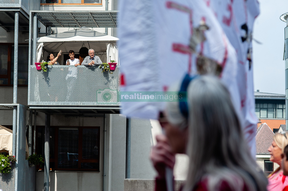 May 1, 2019 - Brussels, North Brabant, Belgium - People are seen at the terrace watching the demonstration..Several trades' unionists gather at the Place Poelaert closer to the Palace of Justice. The demonstration marched to Rouppe in Brussels to fight for decent working conditions, and their rights as workers. Also with this demonstration hundreds of people are looking to conquer new rights, like salary increase, regularization with or without papers, stop sexism and racism, etc. At Central station more groups joined the demonstration, including Antifa block and others left wing groups. These last groups caused some damage on the facades of political party's buildings and destroyed some bus shelters. (Credit Image: © Ana Fernandez/SOPA Images via ZUMA Wire)