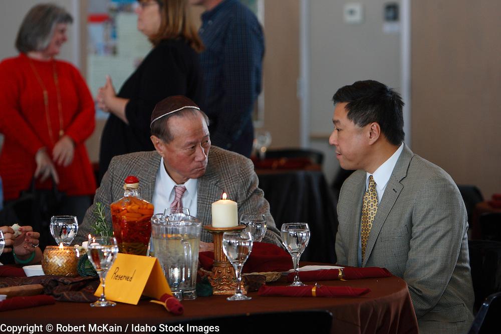 IDAHO. Boise. Asian Jewish men dining at Bat Mitzvah. December 2008. #pa080703 MR