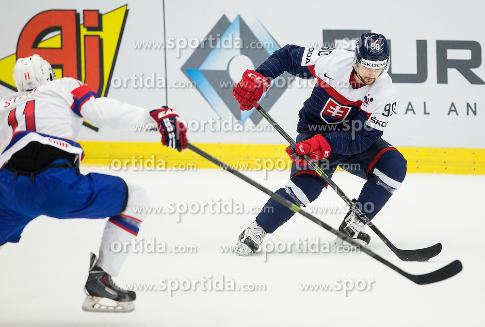 Andreas Stene of Norway vs Tomas Tatar of Slovakia during Ice Hockey match between Slovakia and Norway at Day 6 in Group B of 2015 IIHF World Championship, on May 6, 2015 in CEZ Arena, Ostrava, Czech Republic. Photo by Vid Ponikvar / Sportida