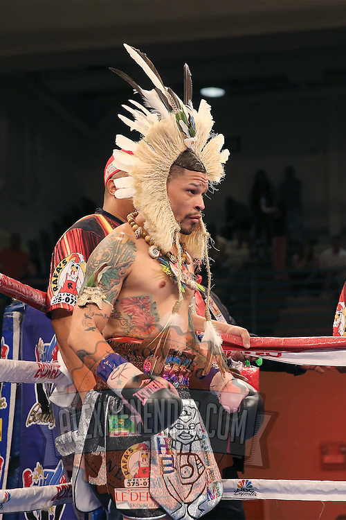 """Orlando """"El Fenomeno""""  Cruz is seen in the ring with his outfit on prior to his match against  Gabino """"Flash"""" Cota during the Boxeo Telemundo WBO/NABO Super Featherweight bout on Friday, October 9, 2015 at the Kissimmee Civic Center in Kissimmee, Florida. Cruz, who is from Puerto Rico, is the first ever openly gay boxer  in the history of the sport and won the bout by unanimous decision.  (Alex Menendez via AP)"""
