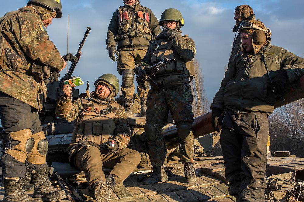 ARTEMIVSK, UKRAINE - FEBRUARY 19: Ukrainian soldiers who left Debaltseve yesterday prepare to return to support the further withdrawal of troops on February 19, 2015 in Artemivsk, Ukraine. Ukrainian forces started withdrawing from the strategic and hard-fought town of Debaltseve yesterday being effectively surrounded by pro-Russian rebels. (Photo by Brendan Hoffman/Getty Images) *** Local Caption ***