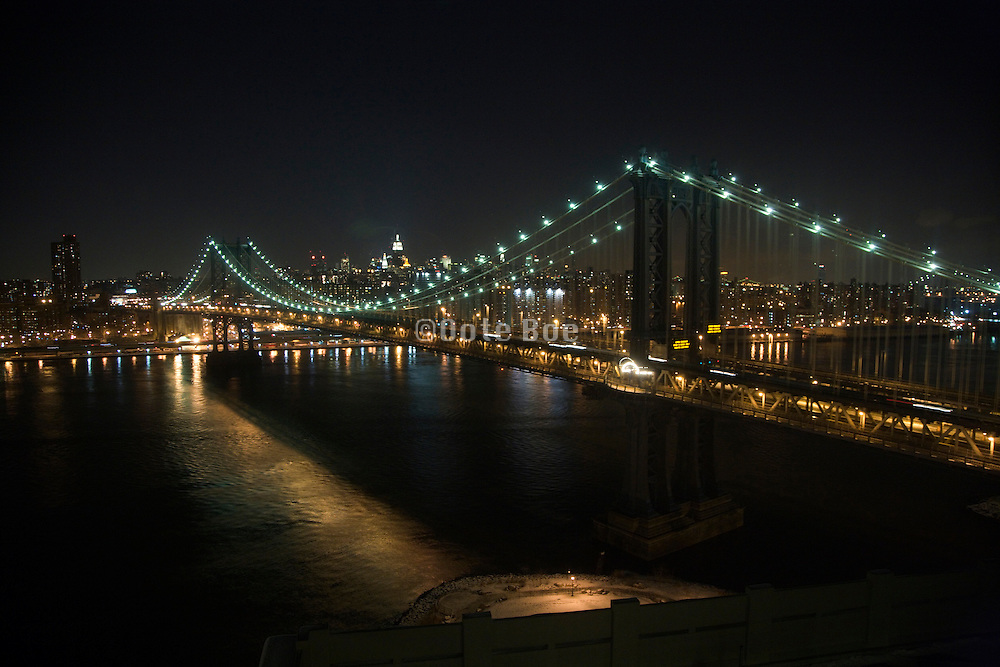Manhattan Bridge with mid town Manhattan and Empire State building in the background