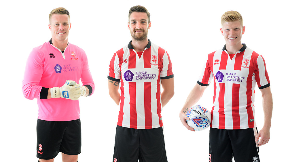 Lincoln City Football Club kit launch ahead of the 2017/18 EFL Sky Bet League Two season.  Pictured is, from left, Lincoln City's Paul Farman, Luke Waterfall and Elliott Whitehouse wearing the Errea home shirt, with the Bishop Grosseteste University logo on the front.<br /> <br /> Picture: Chris Vaughan Photography<br /> Date: June 19, 2017