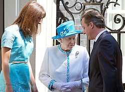 © London News Pictures. 24/07/2012. London, UK. HRH QUEEN ELIZABETH II  being greeted by British Prime Minister DAVID CAMERON and SAMANTHA CAMERON outside 10 Downing street before a lunch with Prime Minister David Cameron on July 24, 2012. Photo credit: Ben Cawthra/LNP.