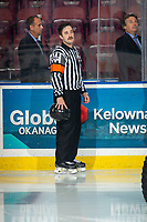 KELOWNA, BC - NOVEMBER 20: Referee Kyle Kowalski stands on the ice during the national anthem at the Kelowna Rockets against the Victoria Royals at Prospera Place on November 20, 2019 in Kelowna, Canada. (Photo by Marissa Baecker/Shoot the Breeze)