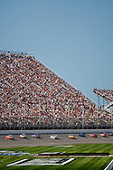 August 16, 2009: The fans watch the racers exit turn four at the CARFAX 400 race, Michigan International Speedway, Brooklyn, MI.