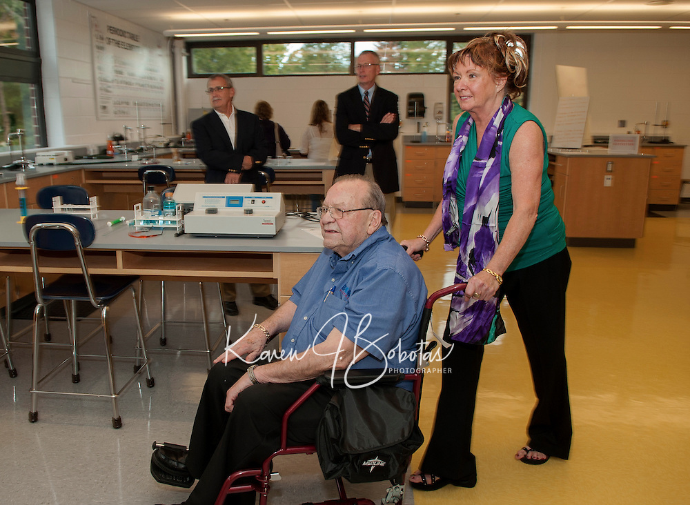 "Dick Dearborn and Sue ""Dearborn"" Monza are among the visitors getting a tour of the new Science Department at Laconia High School Thursday evening.  (Karen Bobotas/for the Laconia Daily Sun)"