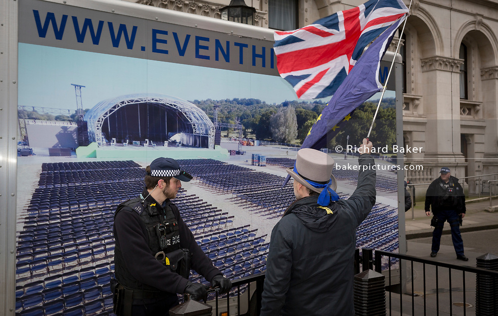 As the EU's Chief negotiator Michel Barnier meets Theresa May in London to discuss the next stage of Brexit, anti-Brexit protesters hold the stars of the EU flag in Whitehall at the entrance of Downing Street, the official residence of the Prime Minister, on 5th February 2018, in London England.