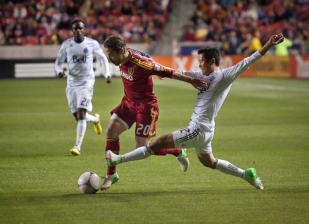Real Salt Lake Midfielder Ned Grabavoy breaks away from Vancouver defender Lee Young-Pyo during the first half of the MLS match between Real Salt Lake and Vancouver Whitecaps FC at Rio Tinto Stadium, Saturday, Oct. 27, 2012.