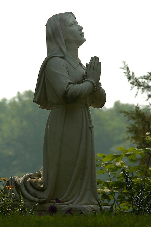Statue of St. Bernadette appears at Redemptorist Retreat Center near Oconomowoc, Wis. (Photo by Sam Lucero)