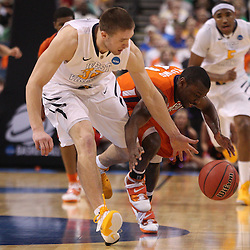Mar 17, 2011; Tampa, FL, USA; West Virginia Mountaineers guard Dalton Pepper (32) steals the ball from Clemson Tigers guard Andre Young (11) during the second half of the second round of the 2011 NCAA men's basketball tournament at the St. Pete Times Forum. West Virginia defeated Clemson 84-76.  Mandatory Credit: Derick E. Hingle