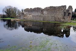 © Licensed to London News Pictures. 18/02/2014. A Kent medieval castle gets a new moat for the first time in centuries. Kent flooding has returned to Eynsford castle's moat to its former glory. The swollen river Darent has recreated the 12th century castle moat. Photo credit :Grant Falvey/LNP