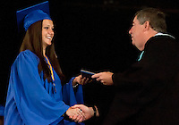 Jennifer Manu is congratulated by Gilford High School Principal Kenneth Wiswell as she receives her diploma during commencement exercises at Meadowbrook Pavilion Saturday morning.  (Karen Bobotas/for the Laconia Daily Sun)Gilford High School Graduation at Meadowbrook Pavilion Saturday, June 11, 2011.