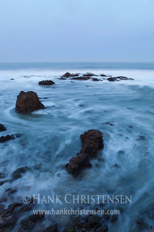 A long exposure turns the surf into an ethereal mist in the moment just before dawn, Pescadero State Beach, California
