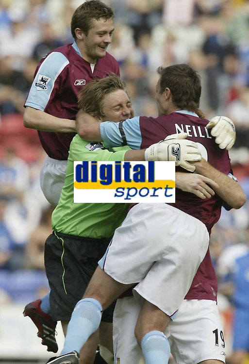 Photo: Aidan Ellis.<br /> Wigan Athletic v West Ham United. The Barclays Premiership. 28/04/2007.<br /> West Ham's Lucas Neill Robert green and George McArtney celebrate the third goal