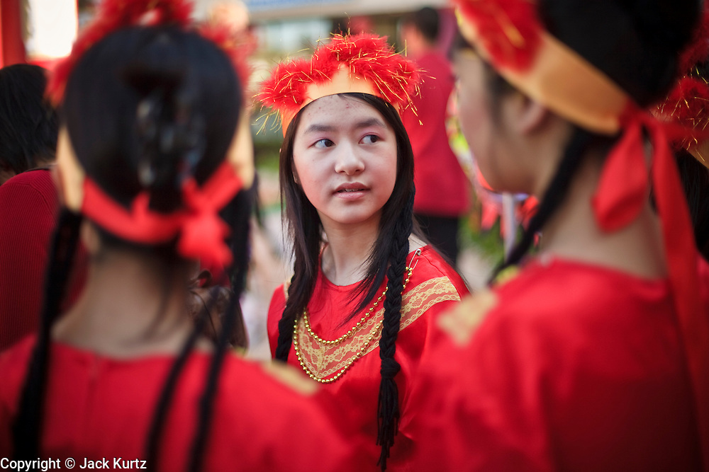 """14 FEBRUARY 2010 - PHOENIX, AZ: Girls get ready to perform a traditional Chinese dance during Chinese New Year celebrations in Phoenix, AZ. This marks the Chinese """"Year of the Tiger."""" The Chinese New Year Celebration at the COFCO Chinese Cultural Center in Phoenix attracted thousands of people. The celebration featured traditional Chinese entertainment and food.  PHOTO BY JACK KURTZ"""