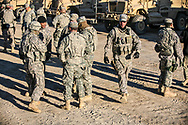 Memebers of the LANG 2228 MP's gather before a mission in Basra, Iraq