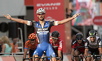LONDON UK 30TH JULY 2016:  Tom Boonen of Etixx – Quick-Step (Bel) crosses the finish line to win the Prudential RideLondon Surrey Classic.. The Prudential RideLondon FreeCycle event over closed roads around the city. Prudential RideLondon in London 30th July 2016.<br /> <br /> Photo: Eddie Keogh/Silverhub for Prudential RideLondon<br /> <br /> Prudential RideLondon is the world's greatest festival of cycling, involving 95,000+ cyclists – from Olympic champions to a free family fun ride - riding in events over closed roads in London and Surrey over the weekend of 29th to 31st July 2016. <br /> <br /> See www.PrudentialRideLondon.co.uk for more.<br /> <br /> For further information: media@londonmarathonevents.co.uk