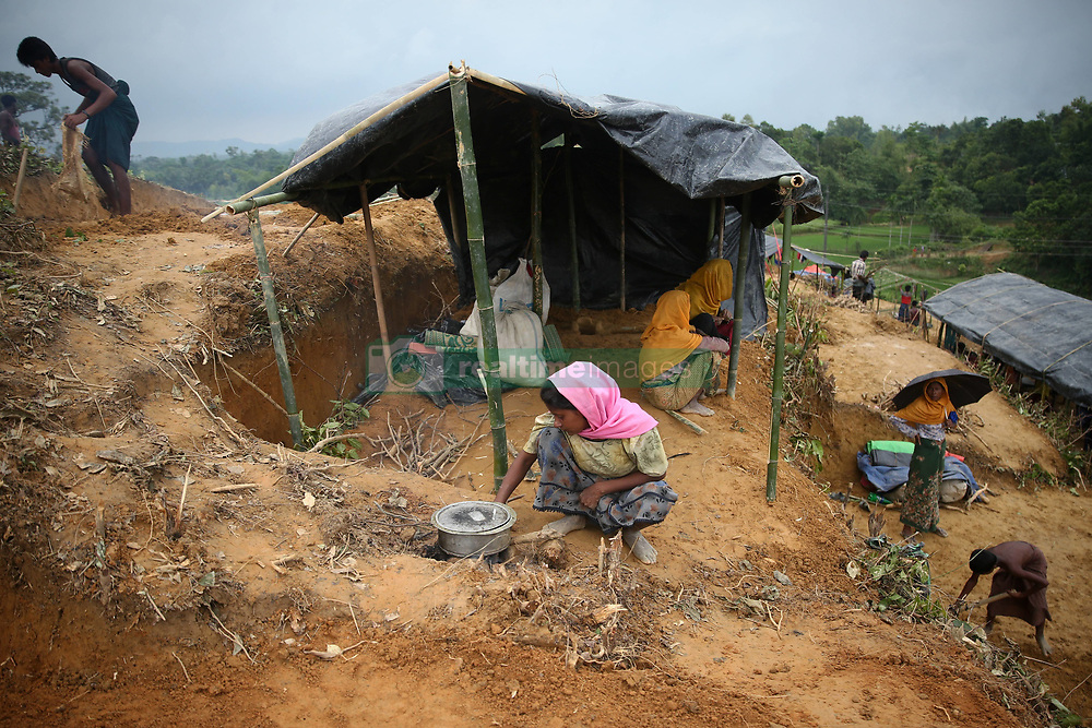 September 4, 2017 - Cox'S Bazar, Bangladesh - Rohingya people build temporary houses on the hill side area near Balukhali, Cox's Bazar, September 4,2017  . Violence erupted in Myanmars Rakhine state on Aug. 25 when the countrys security forces launched an operation against the Rohingya Muslim community. It triggered a fresh influx of refugees towards neighboring Bangladesh, though the country sealed off its border to refugees. (Credit Image: © Mushfiqul Alam/NurPhoto via ZUMA Press)