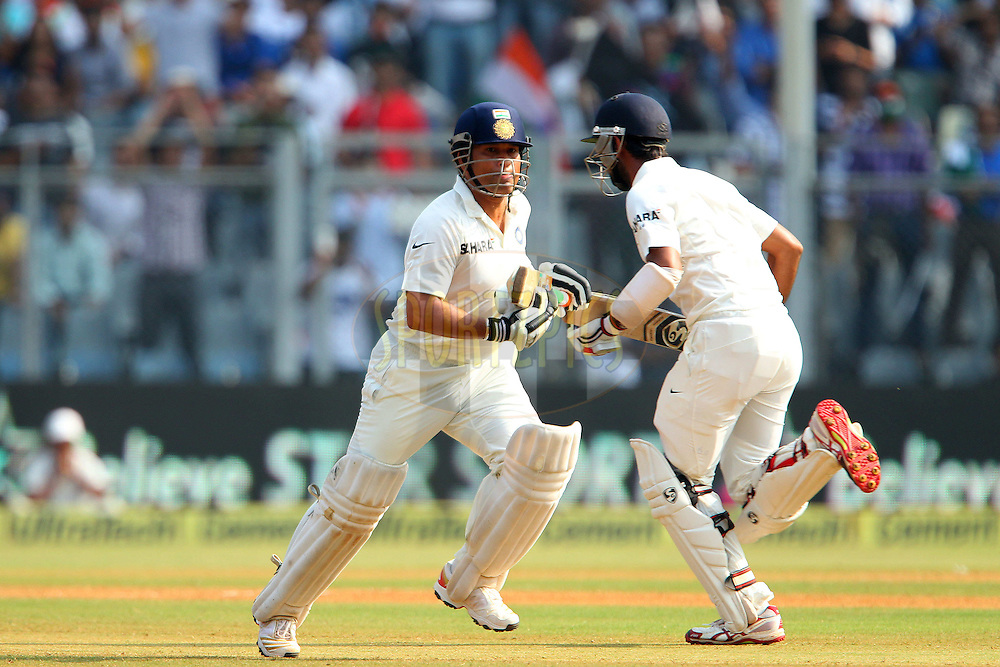 Sachin Tendulkar of India and Cheteshwar Pujara of India make the run during day two of the second Star Sports test match between India and The West Indies held at The Wankhede Stadium in Mumbai, India on the 15th November 2013<br /> <br /> This test match is the 200th test match for Sachin Tendulkar and his last for India.  After a career spanning more than 24yrs Sachin is retiring from cricket and this test match is his last appearance on the field of play.<br /> <br /> <br /> Photo by: Ron Gaunt - BCCI - SPORTZPICS<br /> <br /> Use of this image is subject to the terms and conditions as outlined by the BCCI. These terms can be found by following this link:<br /> <br /> http://sportzpics.photoshelter.com/gallery/BCCI-Image-Terms/G0000ahUVIIEBQ84/C0000whs75.ajndY